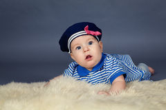 Portrait of happy cute baby girl in sailor dress Stock Photo