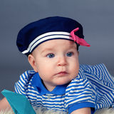 Portrait of happy cute baby girl in sailor dress Stock Photography