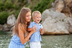 Portrait of happy cute big sister and little brother Stock Images