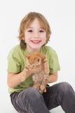 Portrait of happy cute boy holding kitten Stock Photo