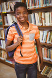 Portrait of happy cute boy in library royalty free stock image