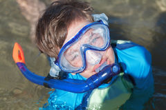 Portrait of happy cute boy wearing snorkeling mask Stock Photo