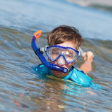 Portrait of happy cute boy wearing snorkeling mask Stock Images