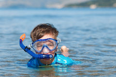 Portrait of happy cute boy wearing snorkeling mask Royalty Free Stock Photos