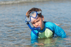 Portrait of happy cute boy wearing snorkeling mask Royalty Free Stock Photo