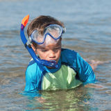 Portrait of happy cute boy wearing snorkeling mask Stock Image