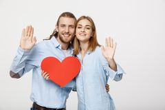 Portrait of happy cute couple in love enjoys Valentine`s Day. A man with a beard and a woman with blond short hair. Portrait of happy cute couple in love enjoys royalty free stock images