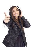 Portrait of happy cute  girl  with headphones listening music a Stock Photos