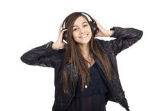 Portrait of happy cute  girl  listening music on her headphones Stock Photo