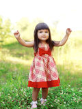 Portrait happy cute little girl child wearing a red dress Stock Photos