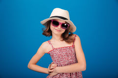 Portrait of happy cute little girl in hat and sunglasses Royalty Free Stock Photos