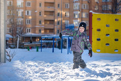 Portrait of happy cute little kid boy in colorful warm winter fashion clothes. Funny child having fun in forest or park on cold da Stock Photography