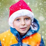 Cute little kid boy with Santa Claus hat Stock Photos