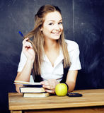 Portrait of happy cute student with book in classroom Royalty Free Stock Image