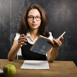 Portrait of happy cute student in classroom. At blackboard Royalty Free Stock Photography
