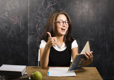 Portrait of happy cute student in classroom Royalty Free Stock Photos