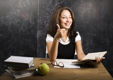 Portrait of happy cute student in classroom Royalty Free Stock Images