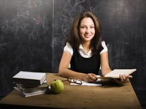 Portrait of happy cute student in classroom Stock Image