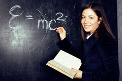 Portrait of happy cute student in classroom at blackboard back t Stock Photo