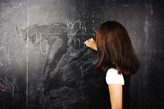 Portrait of happy cute student in classroom at blackboard back t Royalty Free Stock Photo