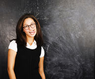 Portrait of happy cute student in classroom at blackboard back to school, crazy emotional, lifestyle people concept Royalty Free Stock Photography