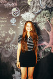 Portrait of happy cute student in classroom at blackboard back to school having fun, girl at college Royalty Free Stock Photography