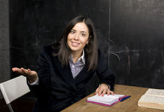 Portrait of happy cute student in classroom thinling Royalty Free Stock Images