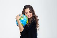 Portrait of a happy cute woman hugging globe Stock Photo