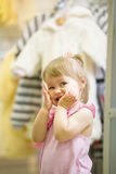 Portrait of happy dancing little girl among toys in children store Royalty Free Stock Photography