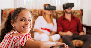 Portrait Of Happy Daughter And Parents Playing Virtual Reality Royalty Free Stock Image