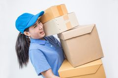 Portrait of happy delivery asian woman her hands holding cardboard box Royalty Free Stock Images