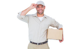 Portrait of happy delivery man with cardboard box wearing cap Stock Photography