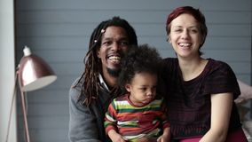 Portrait of happy diverse family with son at home stock footage