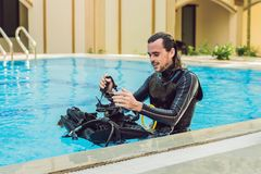Portrait of a happy diving instructor, ready to teach diving in the pool royalty free stock image