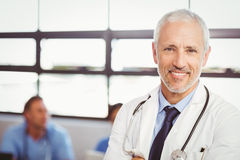 Portrait of happy doctor smiling in conference room royalty free stock photos