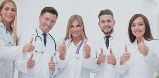 Portrait of happy doctors team showing thumbs up Stock Photography