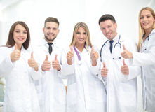 Portrait of happy doctors team showing thumbs up Stock Images