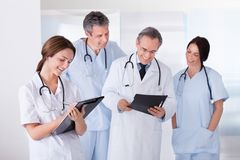 Portrait of happy doctors working together Stock Image