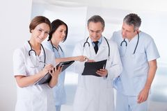 Portrait of happy doctors working together Royalty Free Stock Photos