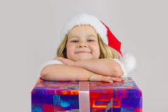 Portrait of a happy dreamer girl in red new year cap Stock Photos