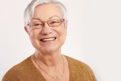 Portrait of happy elderly lady Stock Photo