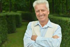 Portrait of happy elderly man Stock Photo