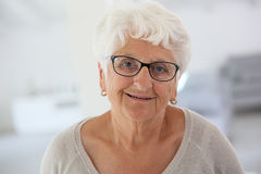 Portrait of happy elderly woman royalty free stock image