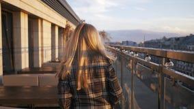 Portrait of happy, elegant woman walking on terrace in bar in 4K stock video footage