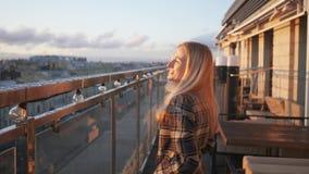 Portrait of happy, elegant woman walking on terrace in bar in 4K stock footage