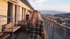 Portrait of happy, elegant woman walking on terrace in bar, slow motion 180fps stock footage