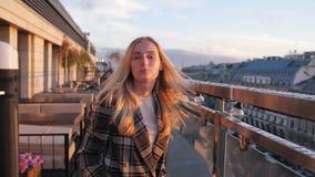 Portrait of happy, elegant woman walking on terrace in bar, slow motion 180fps stock video footage