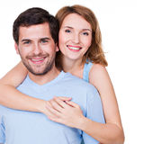 Portrait of happy embracing couple. Portrait of happy embracing couple in casual - isolated on white background royalty free stock photography