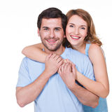 Portrait of happy embracing couple. Portrait of happy embracing couple in casual - isolated on white background stock photo