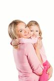 Portrait of happy embracing mother and daughter Stock Photos